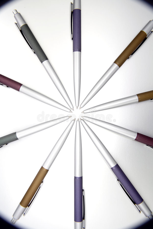 Pens. Lots of ballpoint pens in a circle stock photos