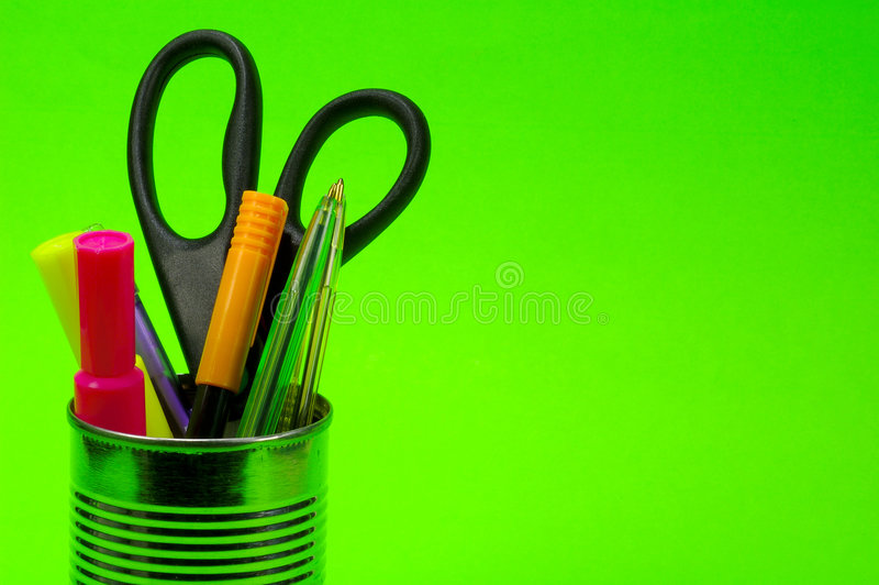 Pens in Can. Pens and Scissor in a Can on a Green Background stock photos