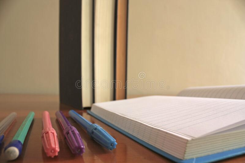 Pens beside notebook royalty free stock photo