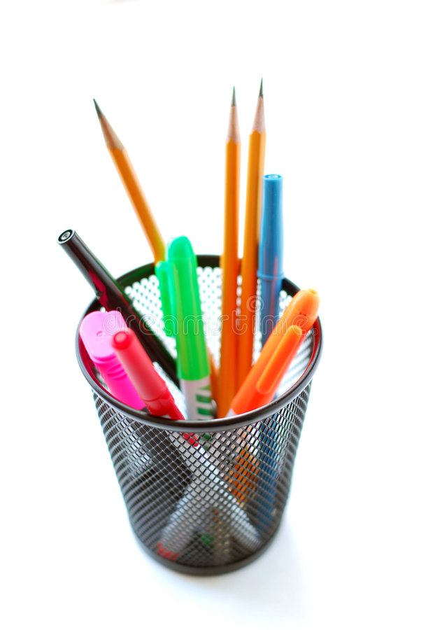 Pens and pencils in pencil holder stock images