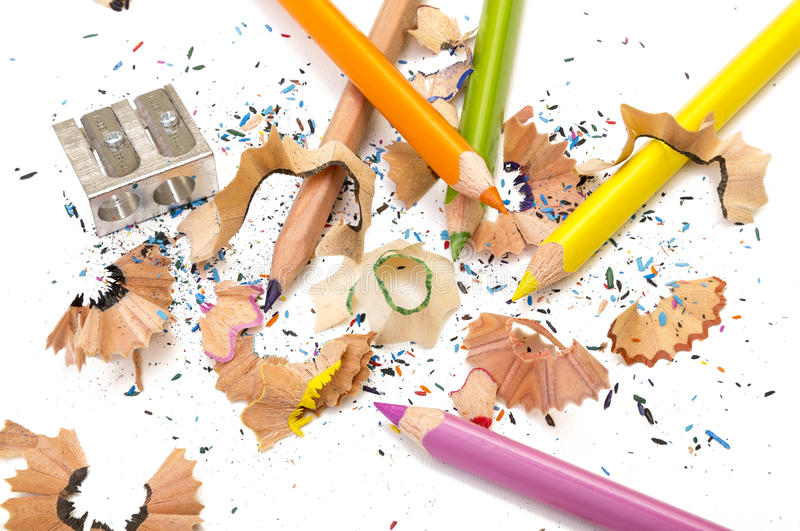 Pens. A set of different colored pens with a sharpener and some trash on a white background royalty free stock image