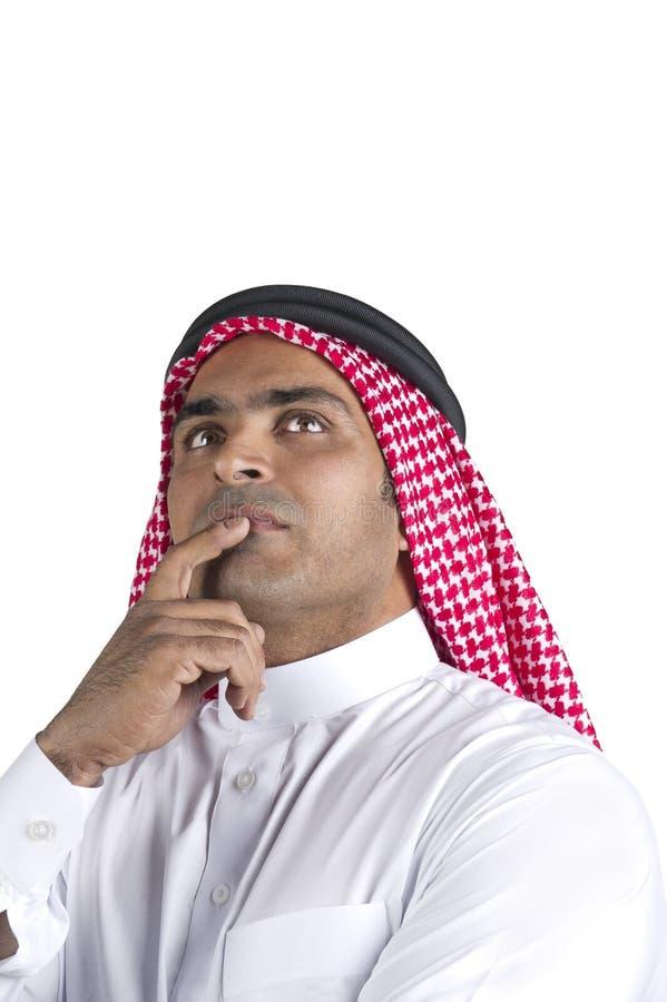 Pensamento árabe tradicional do homem de negócios imagens de stock royalty free