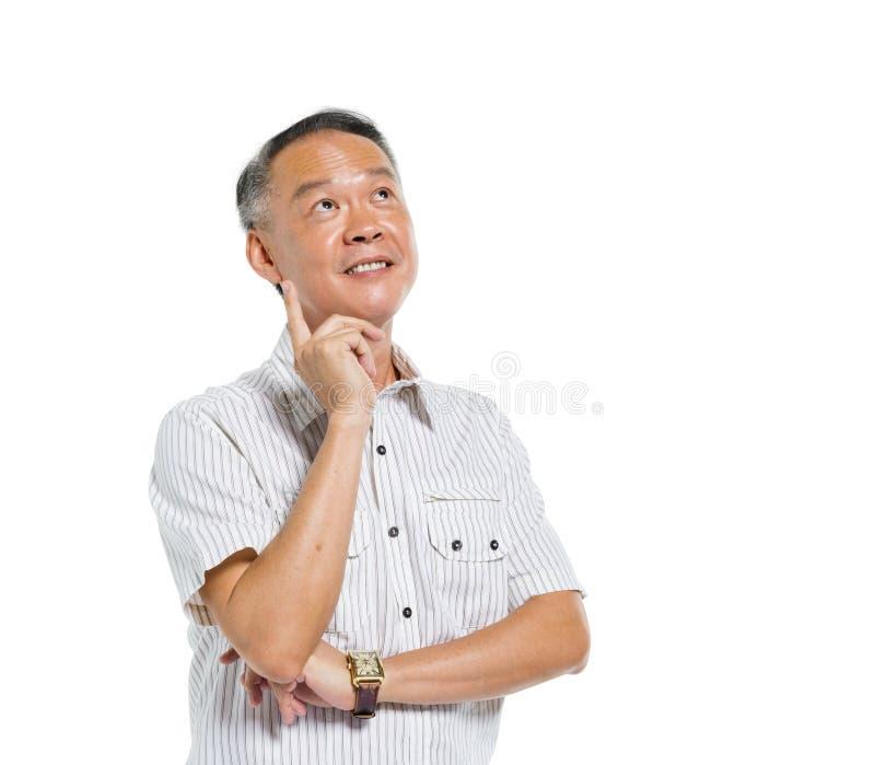 Pensamento asiático maduro alegre do homem fotografia de stock royalty free