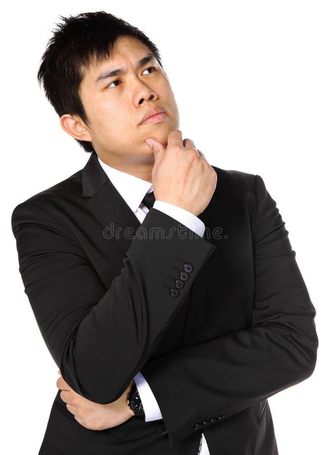 Pensamento asiático novo do homem de negócio fotos de stock
