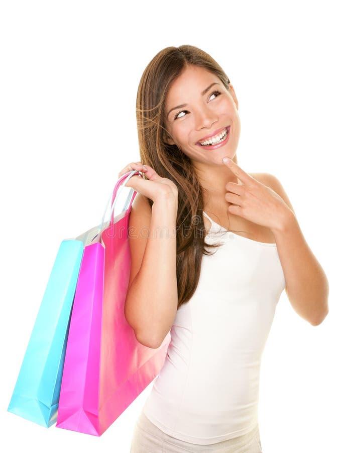Pensamento da mulher da compra imagem de stock royalty free