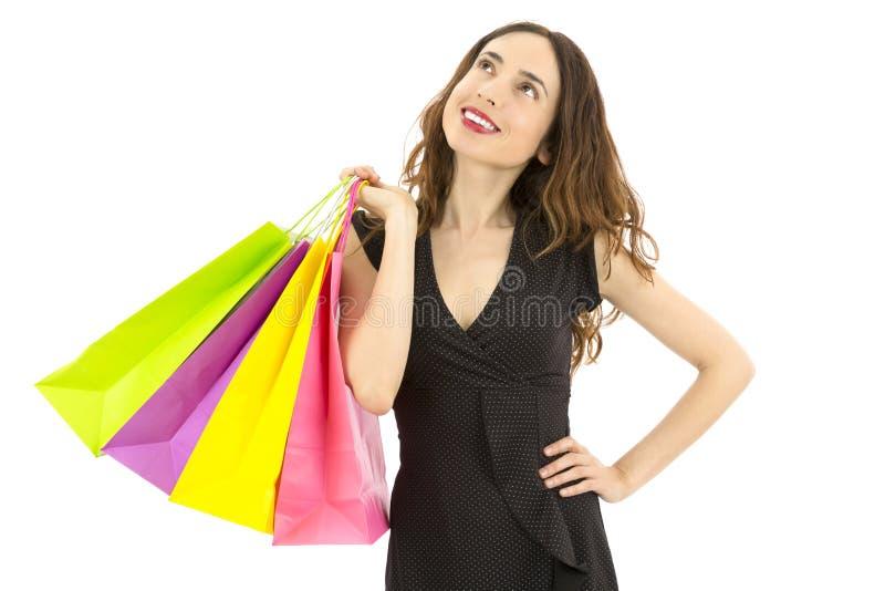 Pensamento da mulher da compra imagem de stock