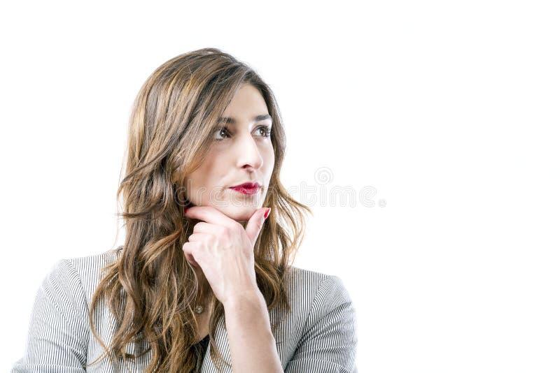 Pensamento da mulher nova imagens de stock