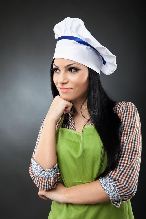 Pensamento do cozinheiro da mulher do Latino imagens de stock