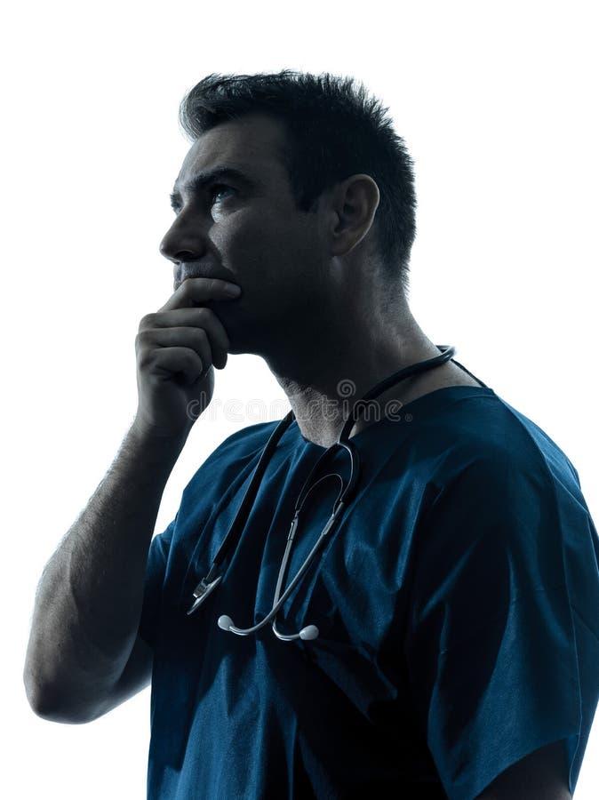 Pensamento do retrato da silhueta do homem do doutor imagens de stock