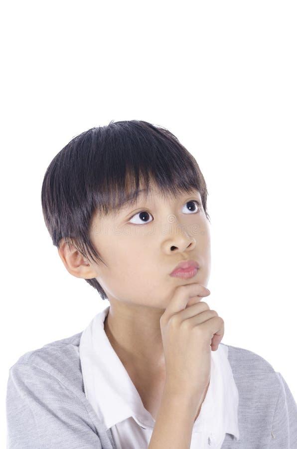 Pensamento esperto do menino foto de stock