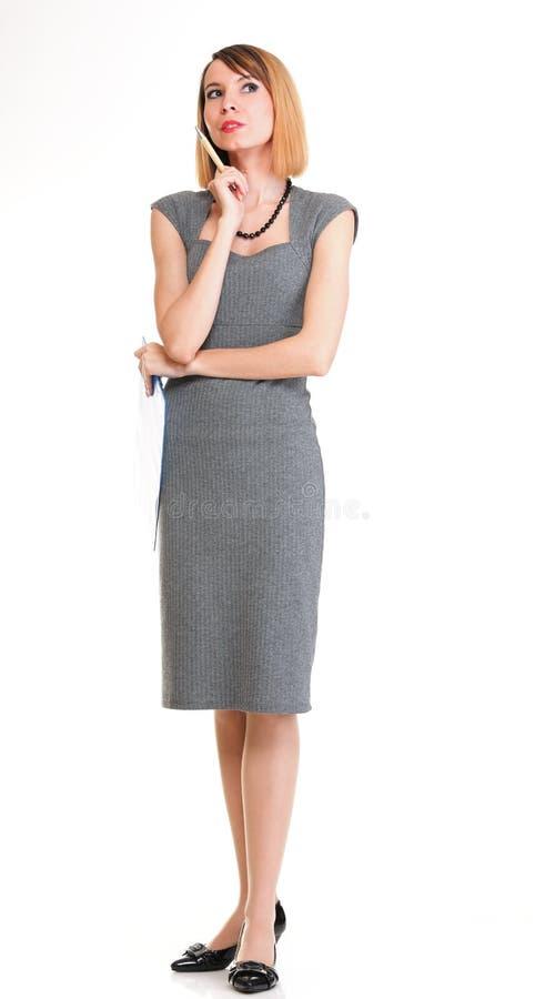 Pensamento novo da mulher de negócio do comprimento completo isolado imagens de stock