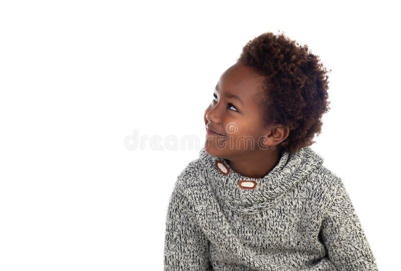 Pensamiento afroamericano adorable del niño fotografía de archivo libre de regalías
