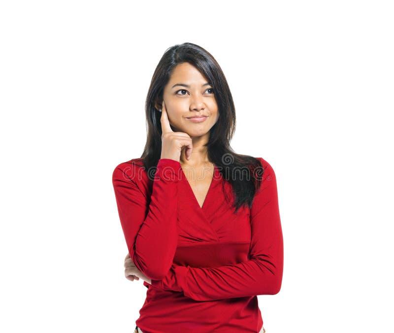 Pensamiento asiático casual joven de la mujer foto de archivo libre de regalías