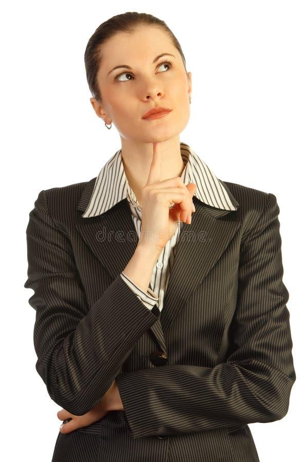 Pensamiento de la mujer de negocios. Aislado en blanco imagenes de archivo