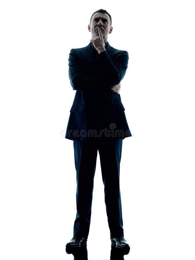 Pensamiento permanente del hombre de negocios aislado fotografía de archivo libre de regalías