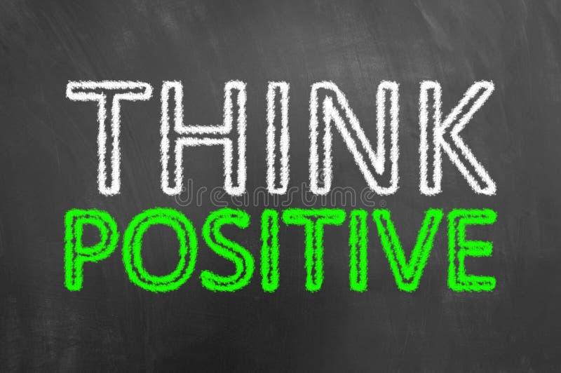 Pense o texto positivo do giz no quadro-negro ou no quadro fotografia de stock royalty free