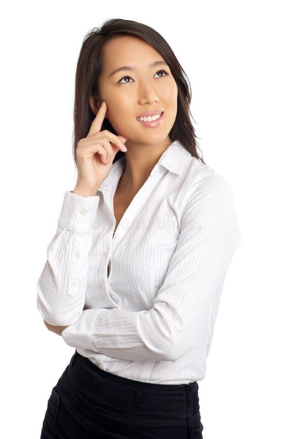 Pensiero asiatico della donna di affari fotografia stock