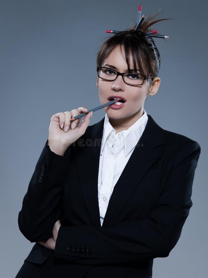Pensiero sexy della segretaria di affari della donna fotografia stock