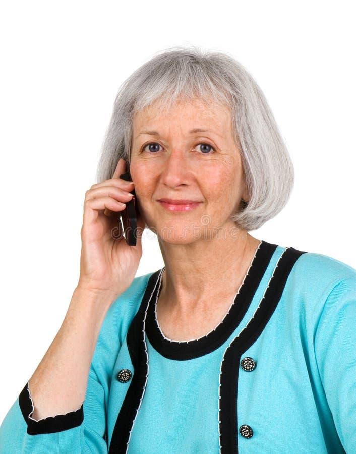 pensionär för affärskvinnacelltelefon royaltyfri fotografi