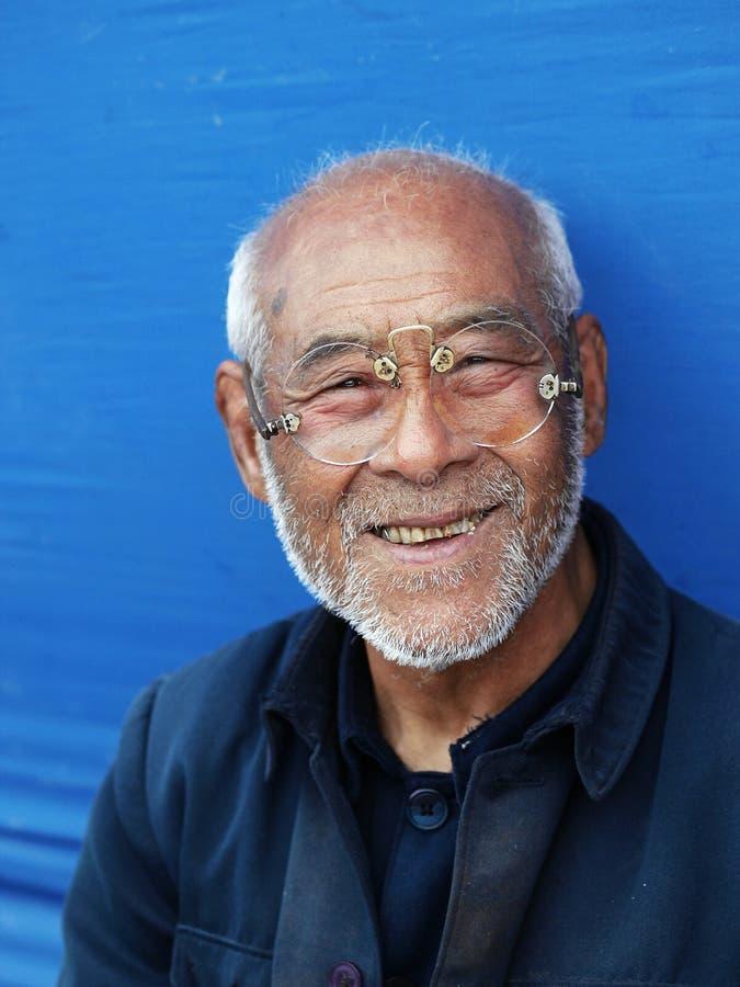 pensionär för stående för asia teknikerpersonage royaltyfria foton