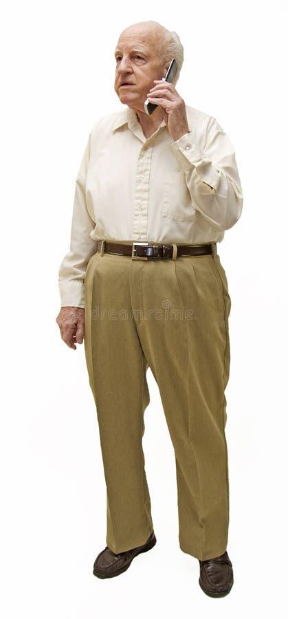 Pensionär på celltelefonen arkivfoto
