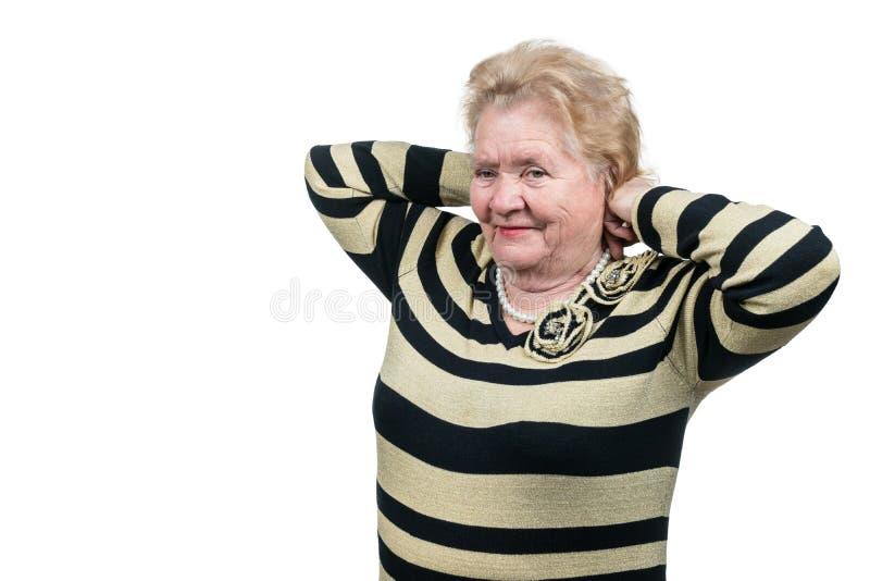 Pensionären försöker pärlor royaltyfria bilder