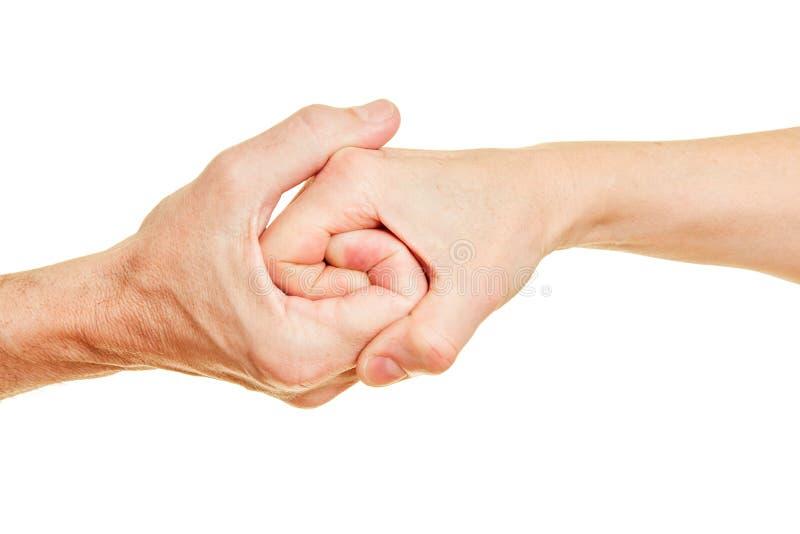 Pensionärer rymmer händer som en spiral arkivfoton