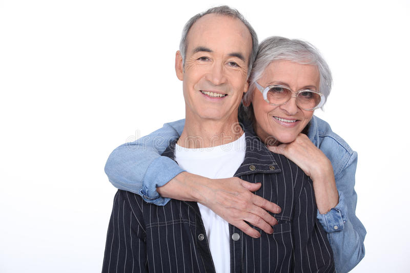 Pensionärer som ser lyckliga arkivfoto