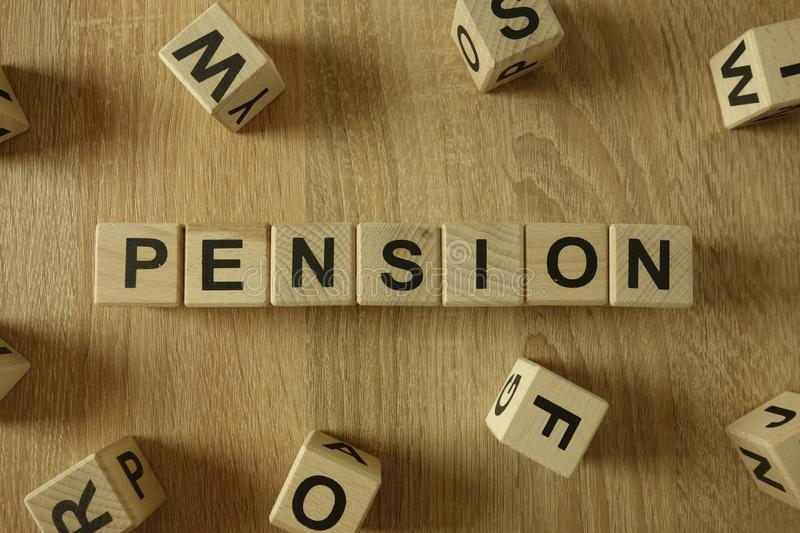 Pension word from wooden blocks. On desk royalty free stock photo