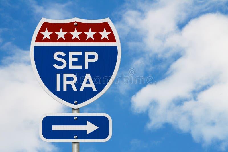 Pensionamento con l'itinerario di piano SETTEMBRE DI IRA su un segnale stradale della strada principale di U.S.A. fotografia stock libera da diritti