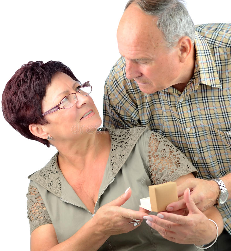 Pensioner couples happy anniversary. Anniversary gift from senior men to his wife royalty free stock photo