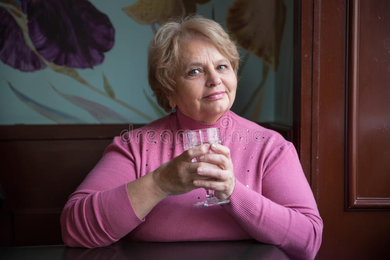 Pensioner Russian woman in cafe stock photo