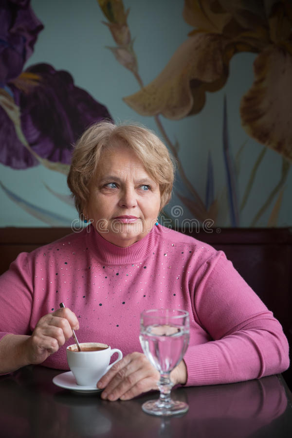 Pensioner Russian woman in cafe royalty free stock photos
