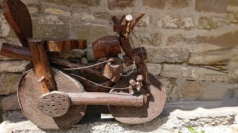 A pensioners wooden motorbikes creations. In a tiny village deep inside the Tuscany hills, Italy, a local pensioner shows his amazing creativity building royalty free stock photos