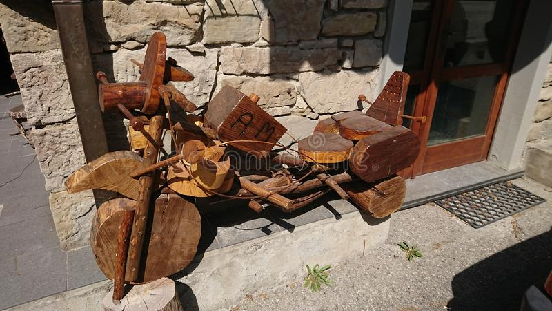 A pensioners wooden motorbikes creations. In a tiny village deep inside the Tuscany hills, Italy, a local pensioner shows his amazing creativity building royalty free stock images