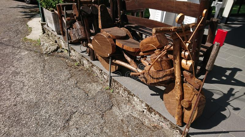 A pensioners wooden motorbikes creations. In a tiny village deep inside the Tuscany hills, Italy, a local pensioner shows his amazing creativity building stock photos