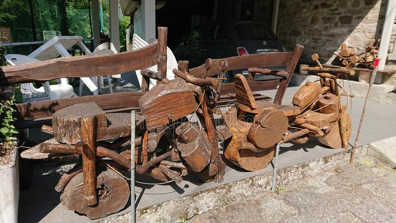 A pensioners wooden motorbikes creations. In a tiny village deep inside the Tuscany hills, Italy, a local pensioner shows his amazing creativity building royalty free stock photo