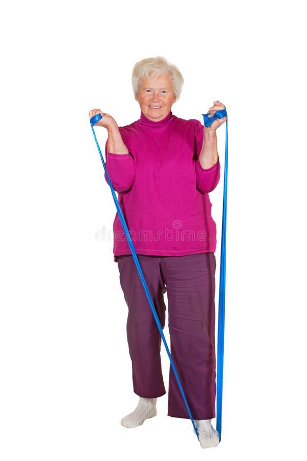 Download Pensionista Que Exercita Com Cinta Imagem de Stock - Imagem de senhora, velho: 26512083