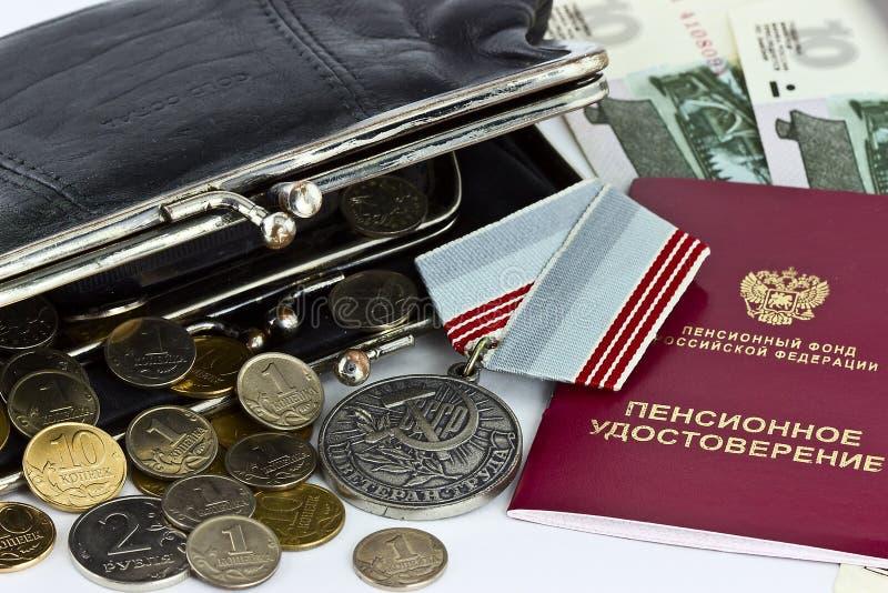 Pensionszertifikat und Medaillenveteranenarbeit lizenzfreie stockfotografie