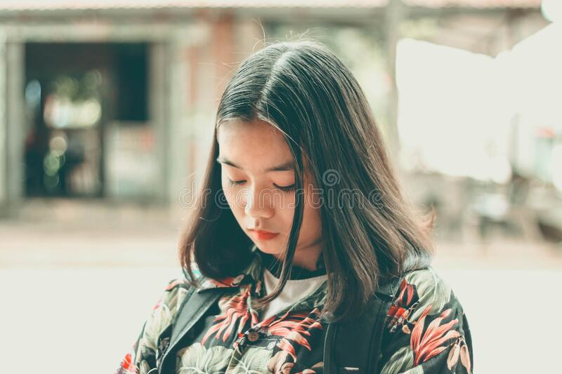 Pensive Asian girl royalty free stock photo