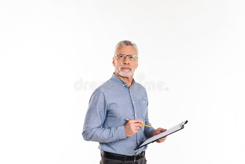 Pensive bearded man looking up and thinking while holding folder isolated royalty free stock photography