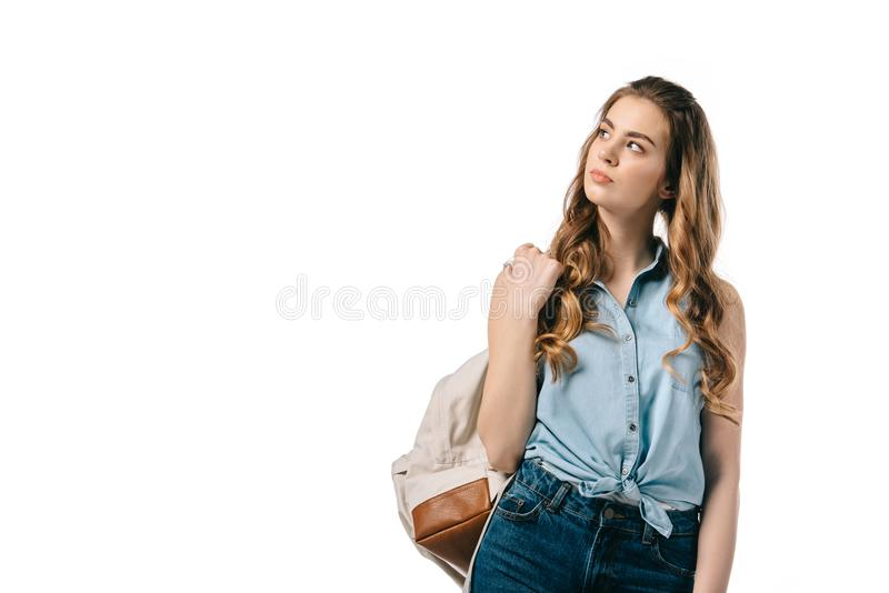 pensive beautiful student looking up stock photo