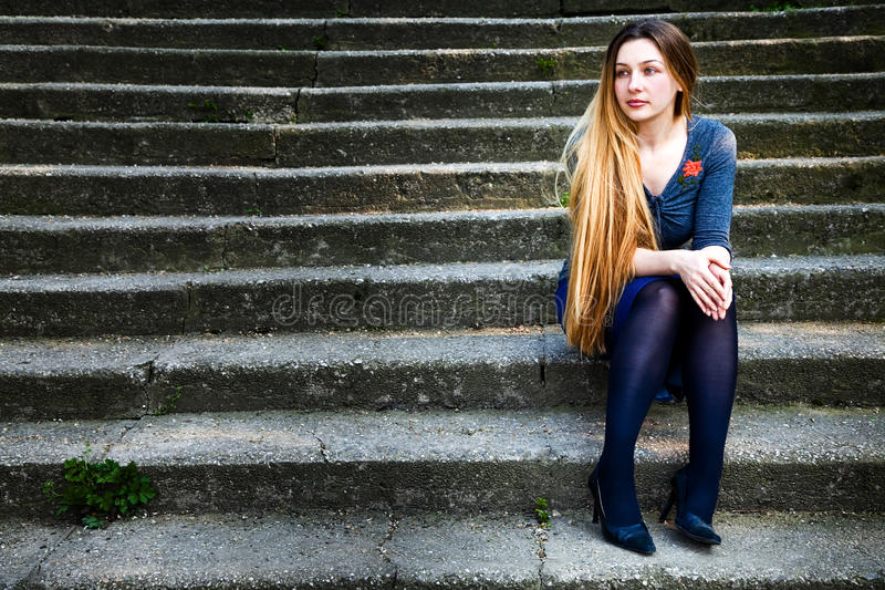 Download Pensive Beautiful Woman On Stone Steps Stock Photo - Image: 9389590