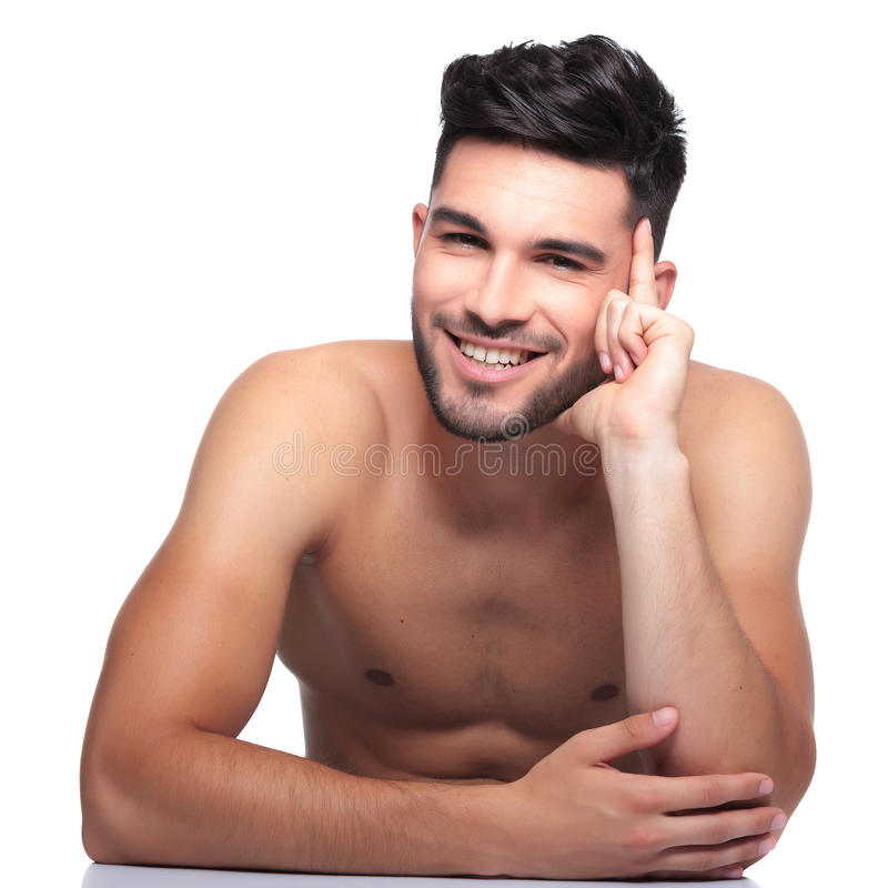 Pensive beauty naked man is laughing royalty free stock photography