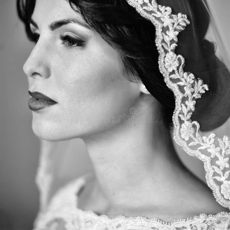 Pensive brunette bride stock photo