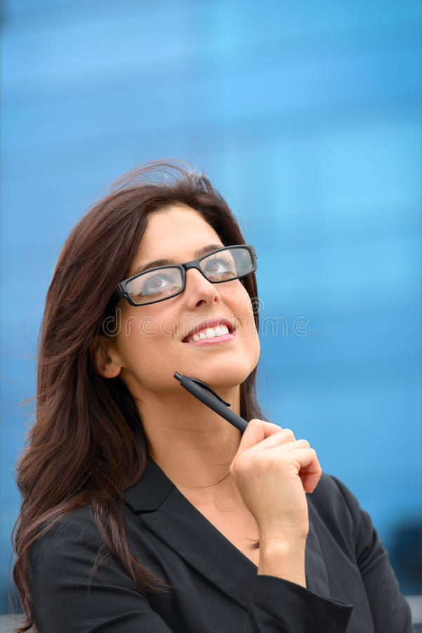 Pensive brunette businesswoman stock photos
