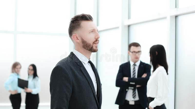 Pensive business man looking through office window royalty free stock photo