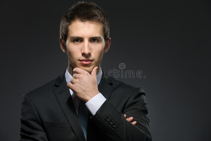Pensive Business Man Touches His Face Royalty Free Stock Photography