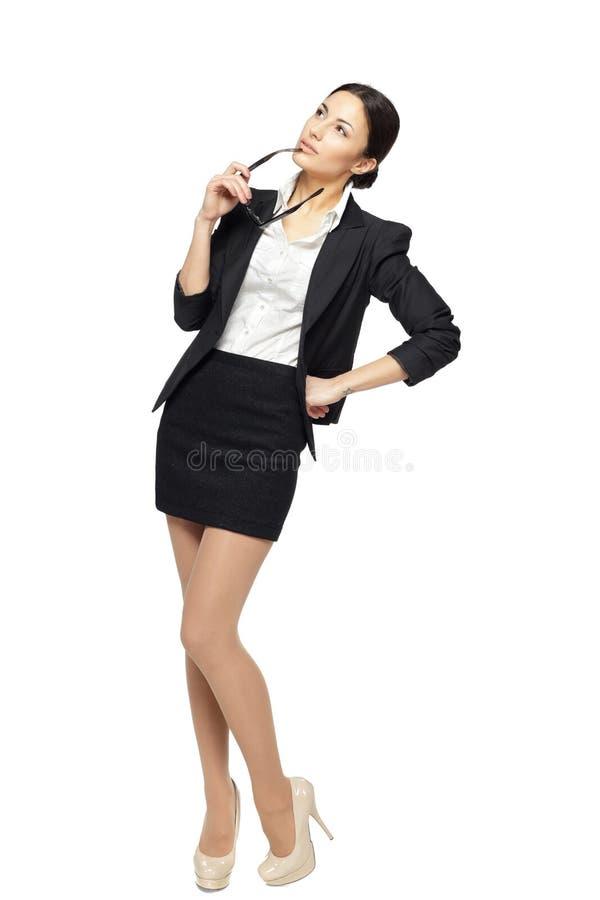Pensive business woman looking away stock photos