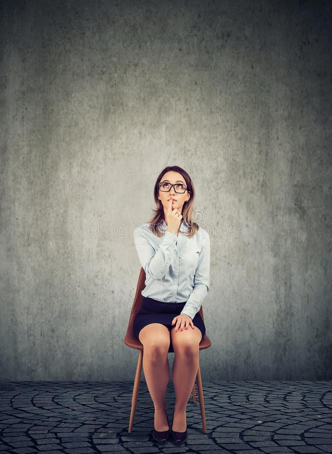 Serious business woman thinking in an empty office royalty free stock photo